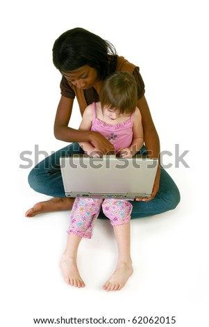Attractive 20 year old African American woman helping 5 year old girl with laptop over white. - stock photo