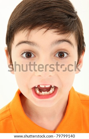 Attractive 8 year old boy close up making silly face. - stock photo