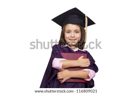 Attractive 5 year old girl in  large graduation cap and gown with diploma over white background