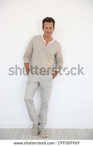 Attractive 40-year-old man on white background - stock photo