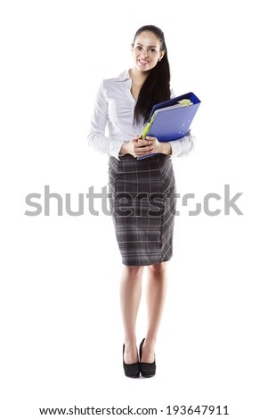 attractive yong business woman holding binder file - stock photo