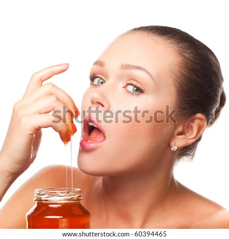 attractive young adult with honey in the pot isolated on white - stock photo