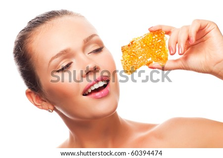 attractive young adult with tasty honeycomb isolated on white background - stock photo
