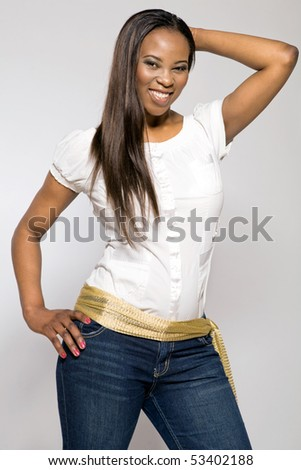 Attractive young african-american girl in blue jeans. - stock photo