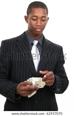 Attractive young african american man in pinstrip suit with large stack of US currency over white background. - stock photo