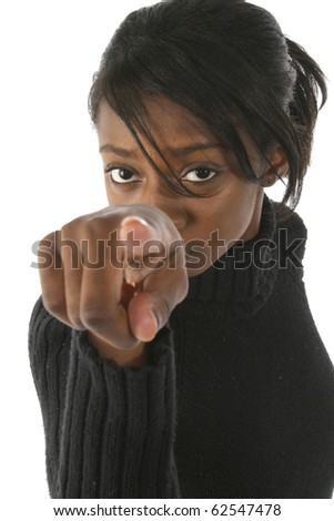 Attractive young african american woman pointing into camera over white background. - stock photo