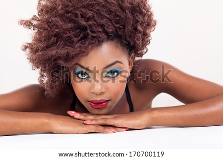 attractive young african beauty on plain background - stock photo