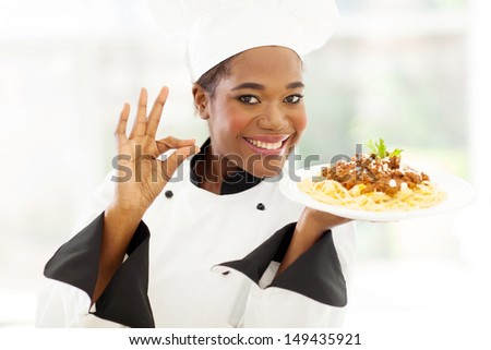 attractive young african chef with delicious pasta dish - stock photo