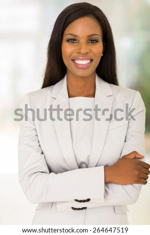 attractive young african woman indoors - stock photo