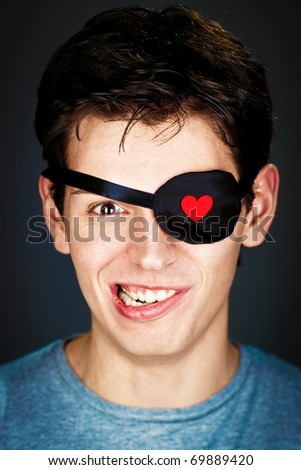 attractive young amorous pirate in the eye-band - stock photo
