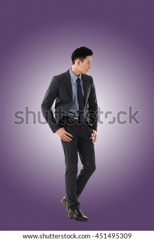 Attractive young Asian businessman, full length portrait isolated - stock photo