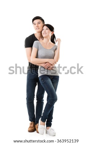 Attractive young Asian couple, full length portrait isolated. - stock photo