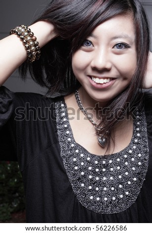 Attractive young Asian female smiling