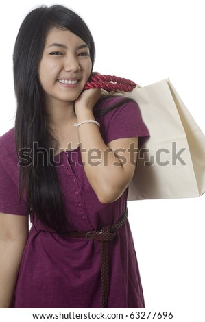 Attractive young Asian girl with shopping bags - stock photo