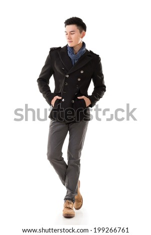 Attractive young Asian man in winter coat, full length portrait isolated on white background. - stock photo