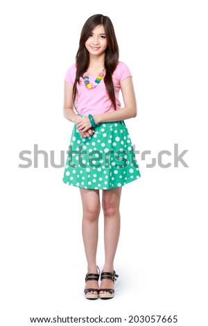 attractive young asian woman standing isolated over white background - stock photo