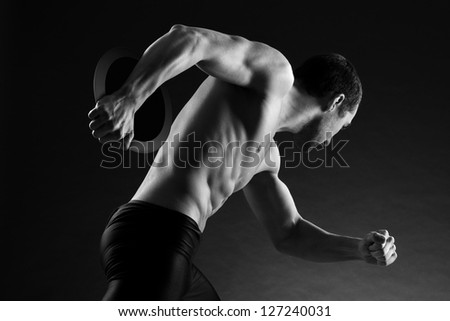 attractive young athlete: discus throwing - stock photo