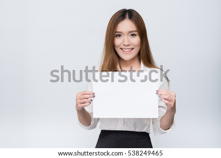 Attractive young beautiful  Asian student woman holding blank white paper