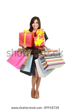 Attractive Young beautiful asian Woman with Shopping Bags and Box isolated on white isolated background - stock photo