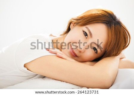 Attractive young beautiful Woman Waking Up In Bed - stock photo