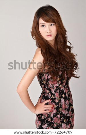 Attractive young beauty of Asian looking, closeup portrait. - stock photo