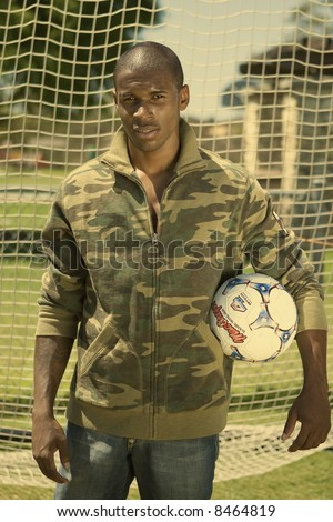 attractive young black man playing hockey - stock photo