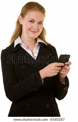 Attractive young blond business woman smiling while holding a pager reading a text message