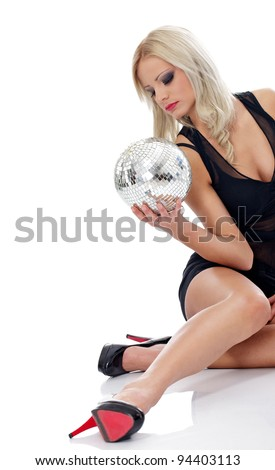 attractive young blond with disco ball - stock photo