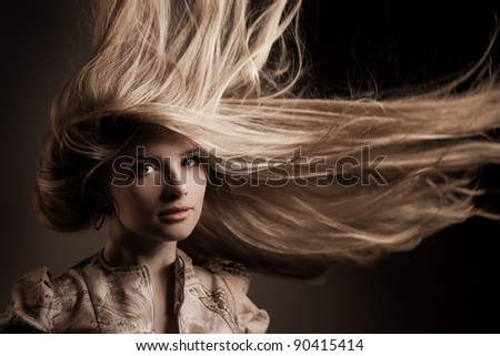Attractive young blond with long hair. Hairstyle in motion