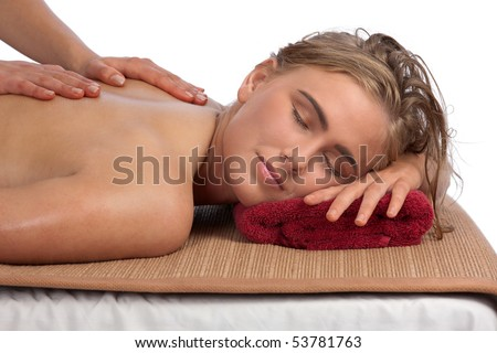 Attractive, young, blond woman gets a rejuvenating massage at the Spa club - stock photo