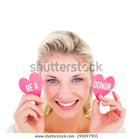 Attractive young blonde holding little hearts against be a donor - stock photo
