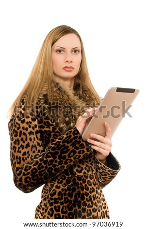 Attractive young blonde lady with the tablet pc - stock photo