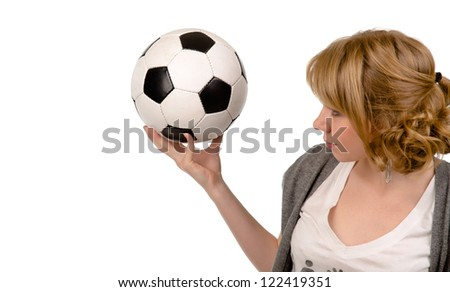 Attractive young blonde woman holding up a black and white soccer ball or football in her hand isolated on white with copyspace - stock photo