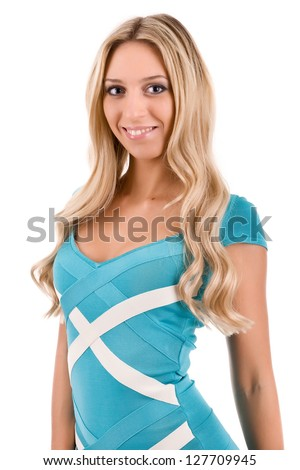attractive young blonde woman in smart dress - stock photo
