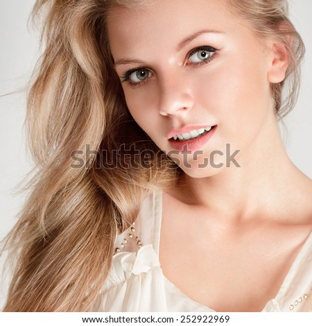 Attractive young blonde woman with long hair - stock photo