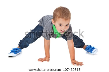 Attractive young boy fooling around. All on white background.
