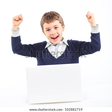 Attractive young boy using notebook computer. Isolated on white background. - stock photo