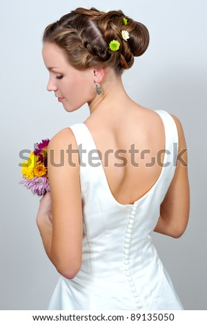 Attractive young bride with beautiful wedding hairstyle - stock photo