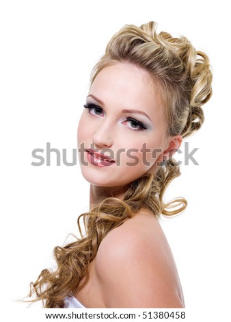 Attractive young bride with beautiful wedding hairstyle - isolated on white - stock photo