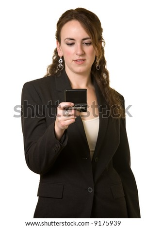 Attractive young brunette business woman reading a pager with text messaging over white
