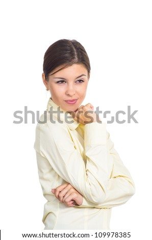 Attractive young brunette businesswoman with a sly glance. Isolated against white background.