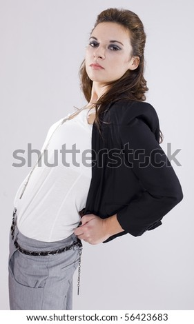 attractive young brunette girl posing in a fashion shooting - stock photo