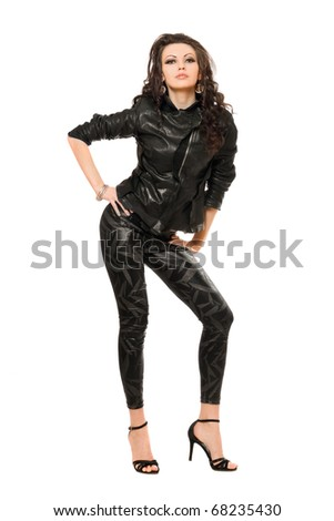 Attractive young brunette in black clothes. Isolated - stock photo