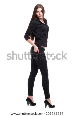 Attractive young brunette wearing black clothes. Isolated on white