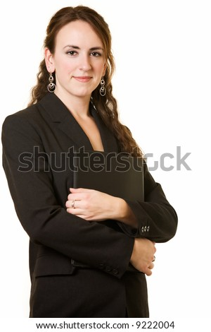 Attractive young brunette woman in black business suit holding a portfolio standing on white