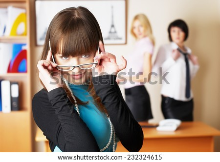 Attractive young business lady at colleagues background in office - stock photo