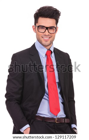 attractive young business man looking at the camera with his hands in his pockets and smiling, isolated on white - stock photo