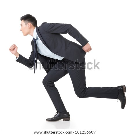 Attractive young business man running, full length portrait isolated on white background.