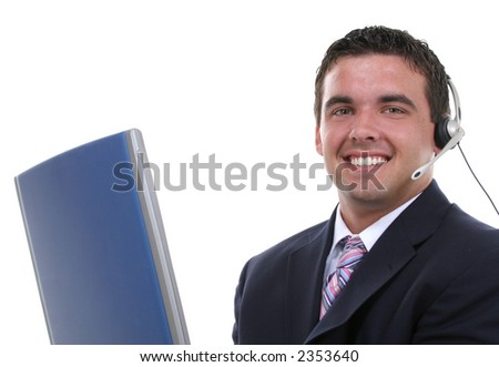 Attractive young business man with headset and laptop. - stock photo