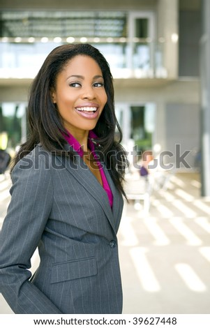 Attractive young business professional outside her office - stock photo
